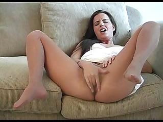 Kobi teasing in a white dress and nude pantyhose